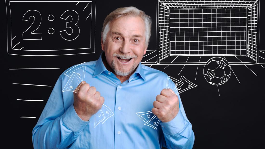 Joyful happy man holding banknotes